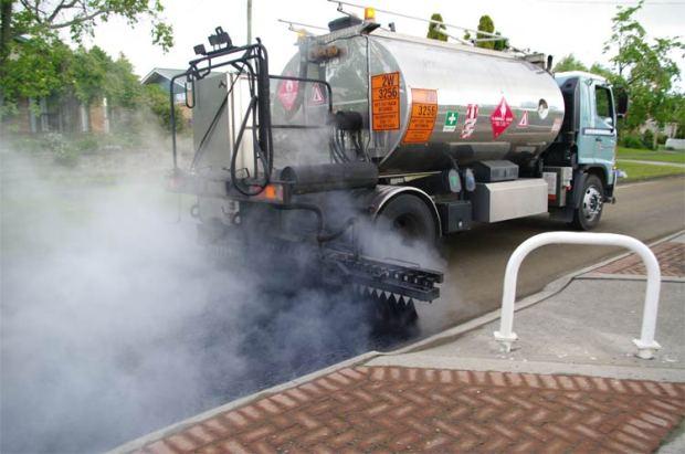 Laying bitumen, Shakespeare Street, Leamington, NZ