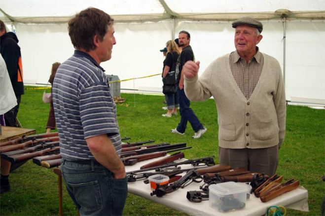 Dad discusses rifles with a vendor at Armistice in Cambridge